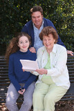 family reading good news poster