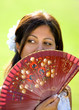 young spanish girl or woman holding traditional fan