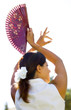 young spanish female dancer with spanish fan