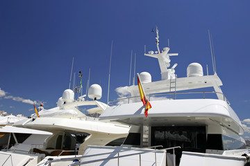 luxury white yachts moored close to each other in spain
