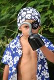 pirate kid looking trough hook poster