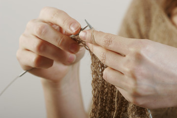 hands at knitting-work