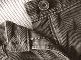 ladies pants with zipper part way undone poster