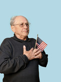 senior man with american flag isolated poster