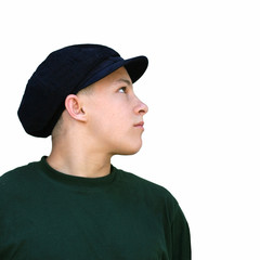 profile of a boy in a hat