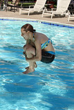 girl jumping in the pool poster