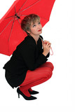 businesswoman with a red umbrella poster