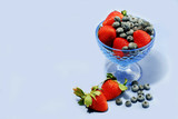 berries on blue poster