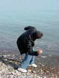 man throwing pebbles poster
