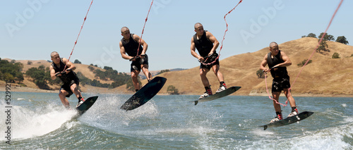 multiple shots of a boy wakeboarding