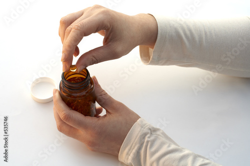 taking a medicine of the bottle