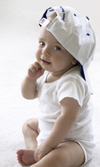 baby in a baseball cap