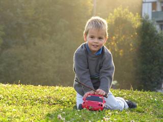 child play wth car on sunset light