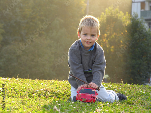 child play wth car on sunset light
