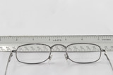 reading eyeglasses on table viewing ruler poster