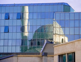 reflection of a mosque poster