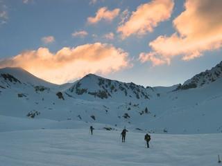 skiers at sunrise