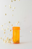 pills falling into and around medicine bottle poster