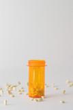 pills in and around medicine bottle poster