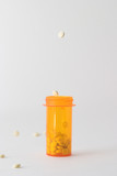 pills falling into and around medicine bottle v3 poster