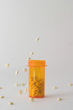 pills falling into and around medicine bottle v4 poster