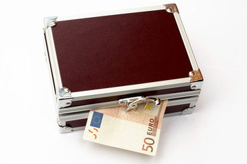 fifty  euros on brown toned metal briefcase, isola