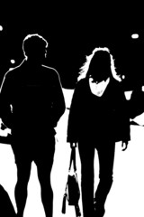 silhouette of people walking together