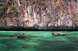longtail boats in turquoise waters poster