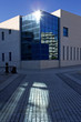 sun on windows of modern office building