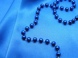 beads on blue material. poster
