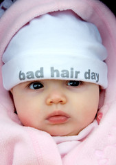 pretty baby girl with funky hat on