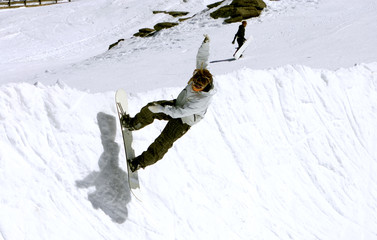 snowboarder on half pipe of prdollano ski resort in spain