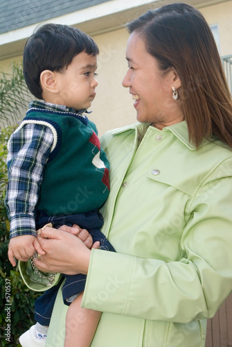 poster of mom trying to make baby smile