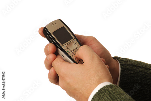male hands dialing cell phone
