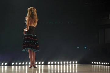 women talking on stage