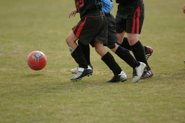 kids playing soccer - football