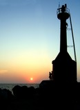 signal tower and ocean sunset poster