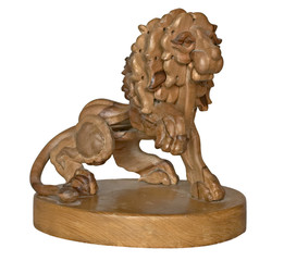 wooden lion on pedestal