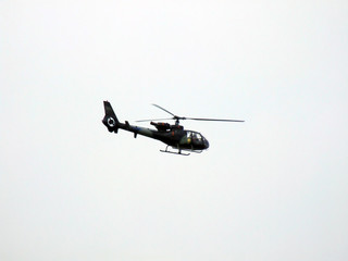 helicopter on sky background