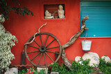 antique wagon wheel fronted by dainty  flowers. poster
