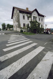 crazy house with pedestrian crossing poster