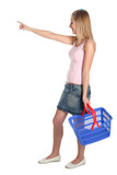 woman with shopping basket poster