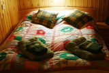 colorful bed linen on a wooden bed poster