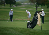 golfers (focus on golf bag) poster