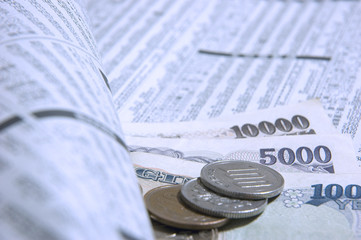 japanese newspaper and money