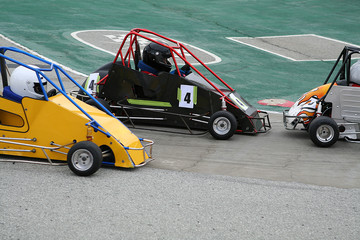 go-kart race (focus on center go-kart)