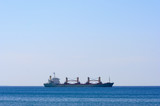 cargo ship at open sea poster