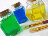 colorful bottles of paint with paint brushes poster