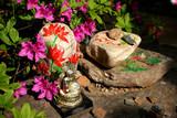 buddha image sitting on painted rocks poster
