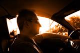 mature man driving a car poster